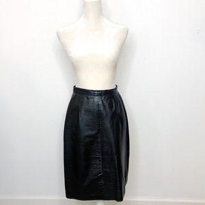 Vintage Black Leather Midi skirt size medium